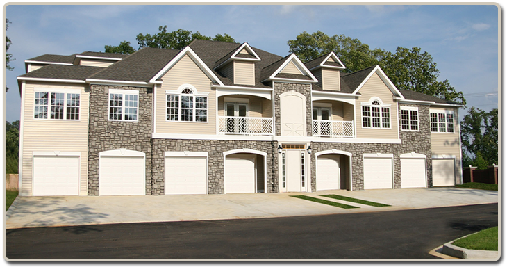A frontal image of the 1 2 and 3 bedroom apartments showing the garages that are available.